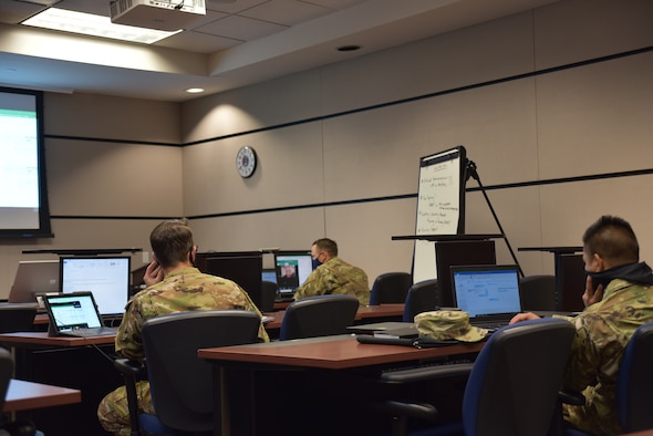 Members of the U.S. Air Force Expeditionary Center host a virtual instructional system development conference with more than 40 participants across multiple U.S. Air Force major commands, July 16, 2020, at Joint Base McGuire-Dix-Lakehurst, New Jersey. The purpose of the conference was to start the development of a training program based on the multi-capable Airmen training syllabus for agile combat employment, which was approved in January. The commands that took part in the virtual instructional system development conference included U.S. Air Forces in Europe-Air Forces Africa, Air Combat Command, Air Mobility Command, Pacific Air Forces, Air Education and Training Command, National Guard Bureau, Air Force Reserve Command, Air Force Global Strike Command, Air Force Flight Standards Agency, and Headquarters Air Force. (U.S. Air Force photo by Maj. George Tobias)