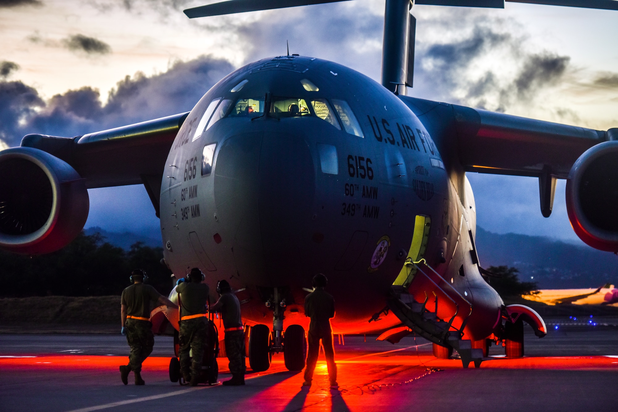 Airmen from the 735th Air Mobility Squadron support a Transport Isolation System operation at Joint Base Pearl-Harbor Hickam, Hawaii, July 17, 2020. Several U.S. Air Force units came together to rapidly deploy the bio-containment capability for the first time in the Indo-Pacific theater in support of a COVID-19 aeromedical evacuation mission. The TIS is an infectious disease containment unit designed to minimize contamination risk to aircrew and medical attendants, while allowing in-flight medical care for patients afflicted by a disease. (U.S. Air Force photo by Tech. Sgt. Anthony Nelson Jr.)