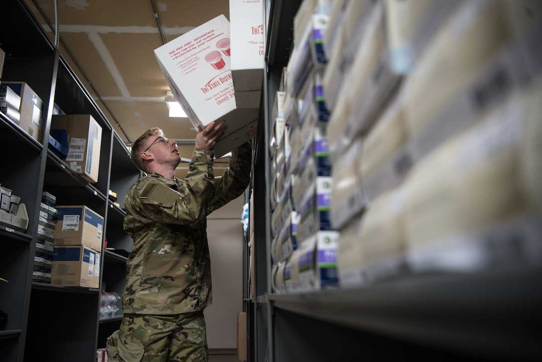 U.S. Air Force Airman 1st Class Bailey Pitcher, 22nd Medical Support Squadron acquisitions technician, prepares equipment at McConnell Air Force Base, Kansas, July 15, 2020. Medical material Airmen can receive an average of four to five shipments a day. Once the medical material team receives packages, they are opened, logged and delivered to the requesting clinic. (U.S. Air Force photo by Senior Airman Alexi Bosarge)
