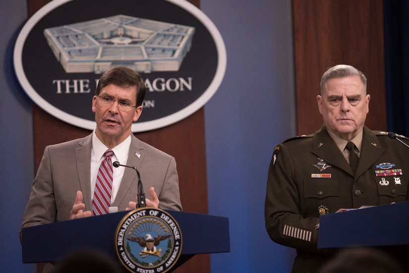 Two men, one in an Army uniform, stand at lecterns in the Pentagon.
