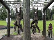 Recruits with Oscar Company, 4th Recruit Training Battalion, navigate an obstacle during the confidence course aboard Marine Corps Recruit Depot Parris Island, S.C., June 22, 2020. The Confidence Course is composed of various obstacles that both physically and mentally challenge recruits.