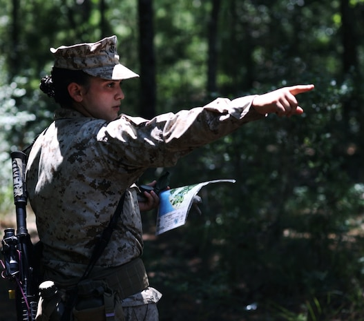 Recruit Raquel Rivera with Papa Company, 4th Recruit Training Battalion, gives directions during the land navigation course aboard Marine Corps Recruit Depot Parris Island, S.C, June 14, 2020. Land navigation is part of Basic Warrior Training and is designed to teach recruits how to use a compass and map for navigation.