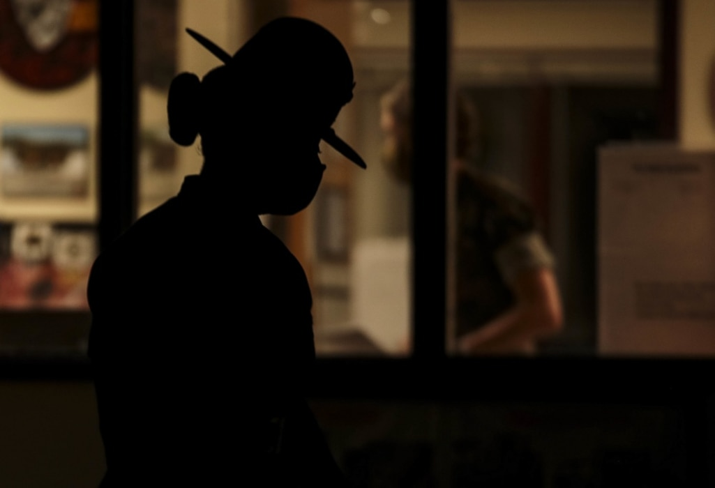 "A drill instructor with Oscar Company, 4th Recruit Training Battalion, prepares to initiate ""Lights"" - the start of her platoon's morning routine - on Parris Island, S.C. July 7, 2020."