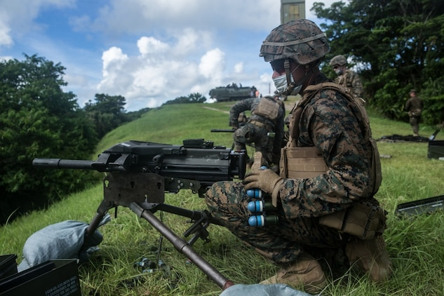 A Marine with Battalion Landing Team, 2nd Battalion, 4th Marines, 31st Marine Expeditionary Unit (MEU) prepares to load 40mm practice M781 rounds into an Mk-19 at Camp Schwab, Okinawa, Japan, June 29, 2020. The 31st MEU, the Marine Corps' only continuously forward-deployed MEU, provides a flexible and lethal force ready to perform a wide range of military operations as the premier crisis response force in the Indo-Pacific region. The 31st MEU has implemented strict health protection measures and will continue to conduct mission essential training in support of regional security and stability. (U.S. Marine Corps photo by Lance Cpl. Kolby Leger)