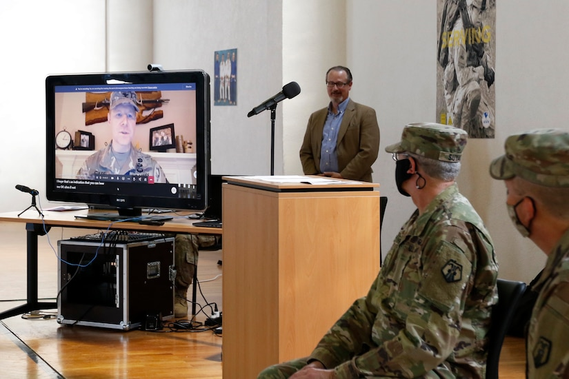 Col. Stephen P. Case, left, speaks to his unit, the 209th Digital Liaison Detachment, during a change of command ceremony July 19, 2020 in Wackernheim, Germany. The detachment, headquartered at U.S. Army Garrison Wiesbaden, is part of the U.S. Army Reserve's 7th Mission Support Command and serves in direct support of U.S. Army Europe.  (U.S. Army Reserve photo by Staff Sgt. Chris Jackson/Released)