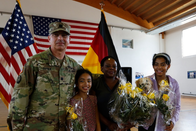 Lt. Col. Frank Suyak and family pose after taking command of the 209th Digital Liaison Detachment July 19, 2020 in Wackernheim, Germany. The detachment, headquartered at U.S. Army Garrison Wiesbaden, is part of the U.S. Army Reserve's 7th Mission Support Command and serves in direct support of U.S. Army Europe.  (U.S. Army Reserve photo by Staff Sgt. Chris Jackson/Released)