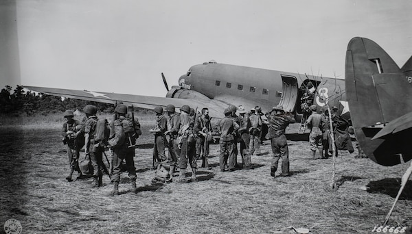 Soldiers with the 2nd Battalion, 127th Infantry, 32nd Division, deplane at the Dubadura Airstrip south of Buna, New Guinea, Dec. 15, 1942.