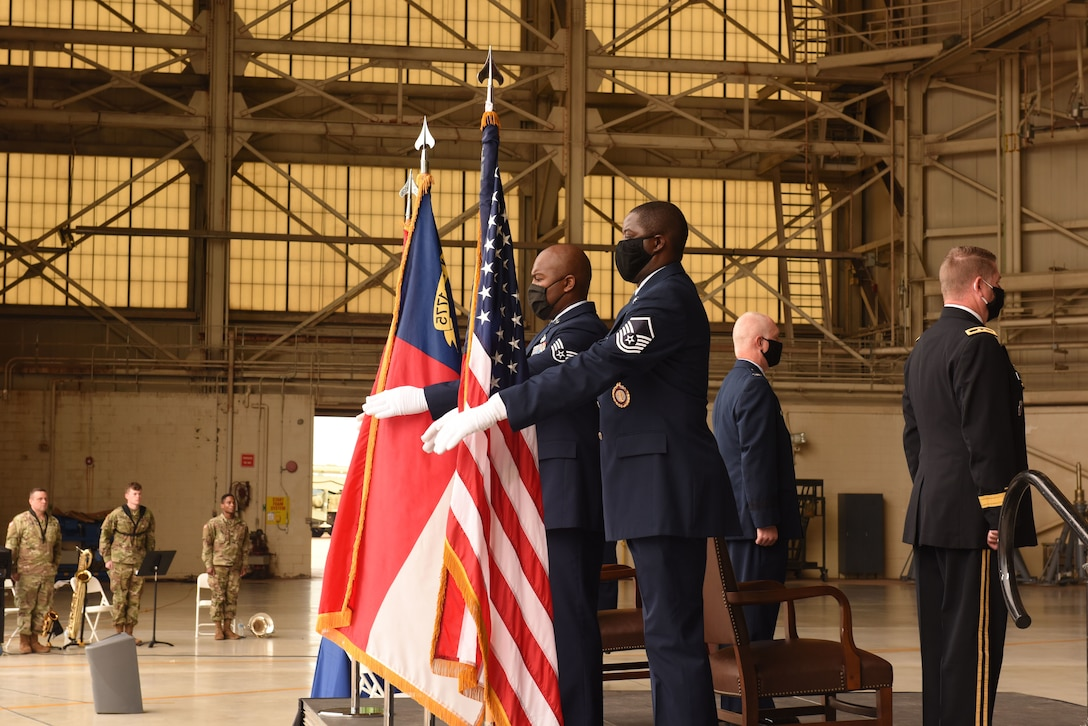 The 145th Airlift Wing Honor Guard posts the Colors during the promotion ceremony of U.S. Air Force Col. Allan R. Cecil, North Carolina National Guard Chief of Staff, held at the North Carolina Air National Guard Base, Charlotte Douglas International Airport, July 18, 2020. Family, friends, and guard members gather to watch Col. Cecil pin on the rank of Brigadier General.
