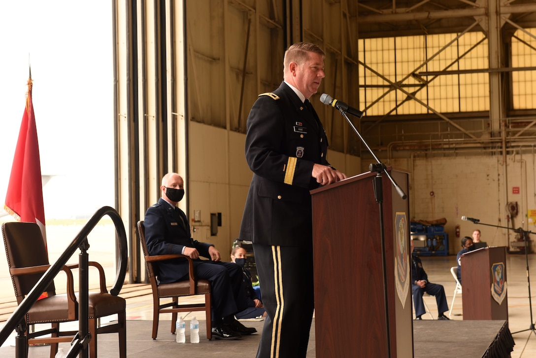 U.S. Army Maj. Gen. M. Todd Hunt (right), the Adjutant General of North Carolina National Guard (NCNG), speaks in high regard of U.S. Air Force Col. Allan R. Cecil (left), NCNG Chief of Staff, during Col. Cecil's promotion ceremony at the North Carolina Air National Guard Base, Charlotte Douglas International Airport, July 18, 2020. Family, friends, and guard members gather to watch Col. Cecil pin on the rank of Brigadier General.