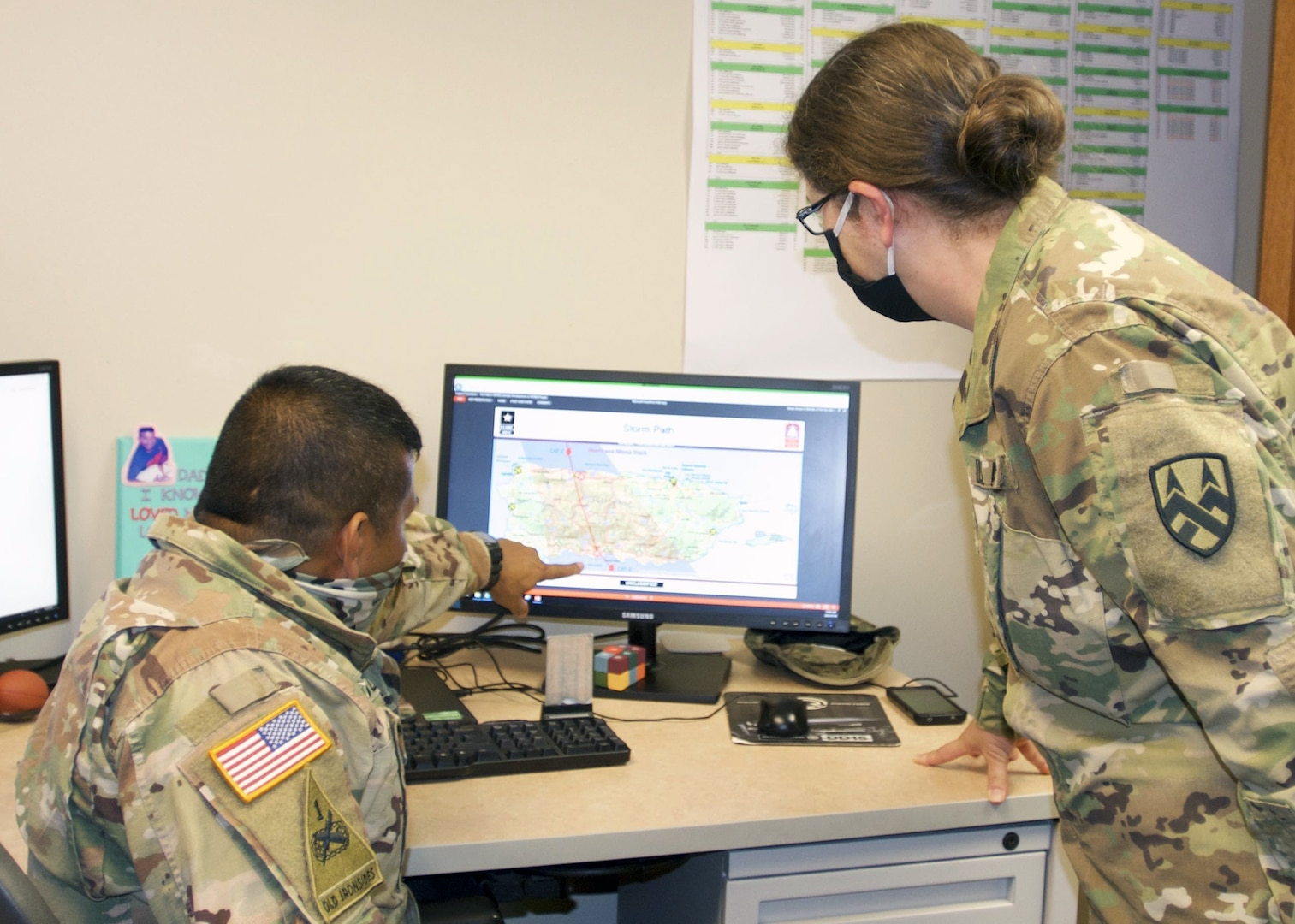 Soldiers looking at compute