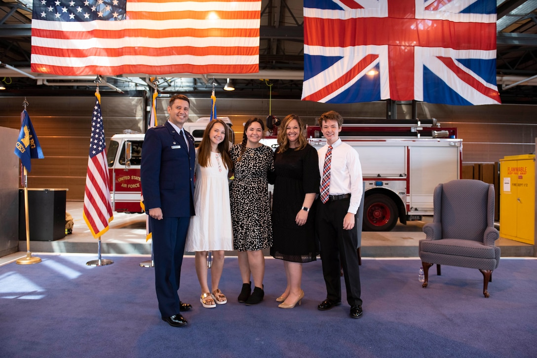 U.S. Air Force Maj. Hans Winkler, 423rd Civil Engineer Squadron (CES) commander, poses for a photo with his family during the 423rd CES Change of Command ceremony at RAF Alconbury, England, July 17, 2020. The change of command ceremony is rooted in military history dating back to the 18th century representing the relinquishing of power from one officer to another. (U.S. Air Force photo by Airman 1st Class Jennifer Zima)