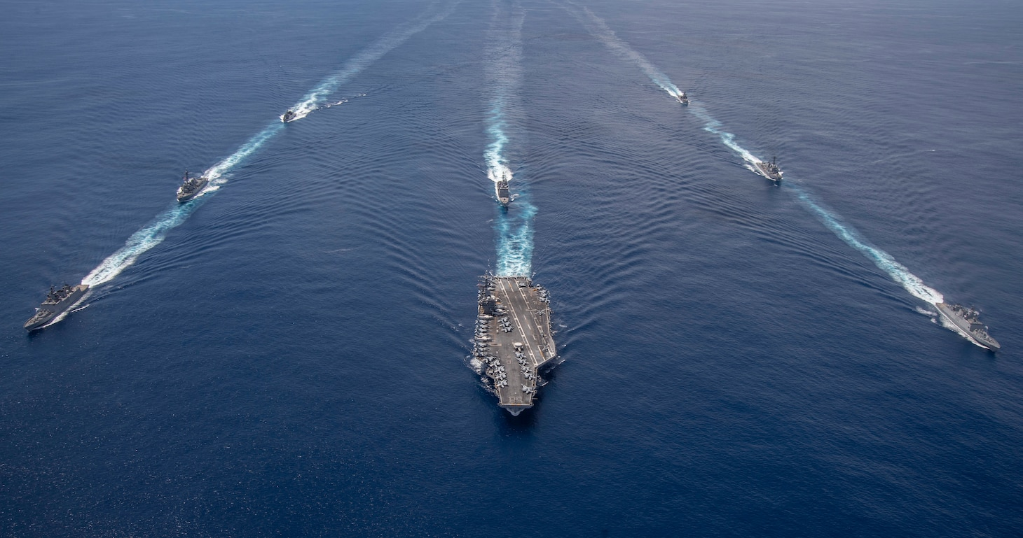 The Nimitz Carrier Strike Group, consisting of flagship USS Nimitz (CVN 68),  Ticonderoga-class guided missile cruiser USS Princeton (CG 59) and Arleigh Burke-class guided missile destroyers USS Sterett (DDG 104) and USS Ralph Johnson (DDG 114), along with Indian Navy ships Rana, Sahyadri, Shivalik and Kamorta, steam in formation during a cooperative deployment in the Indian Ocean June 20.