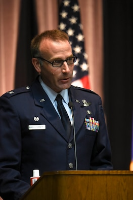 U.S. Air Force Col. Tom McElhinney III, 14th Operations Group commander, speaks at Specialized Undergraduate Pilot Training Class 20-18/19 graduation ceremony July 10, 2020, on Columbus Air Force Base, Miss. After graduating pilot training at Columbus AFB, pilots will now go to their specified base to start training on their assigned aircraft. (U.S. Air Force photo by Senior Airman Keith Holcomb)