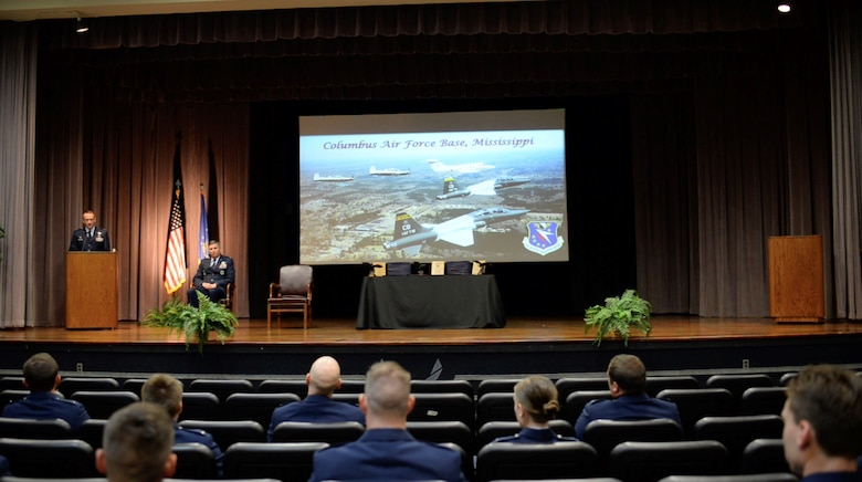 U.S. Air Force Col. Tom McElhinney III, 14th Operations Group commander, speaks at Specialized Undergraduate Pilot Training Class 20-18/19 graduation ceremony July 10, 2020, on Columbus Air Force Base, Miss. The 52-week pilot training program begins with a six-week preflight phase of academics and physiological training to prepare students for flight. (U.S. Air Force photo by Senior Airman Keith Holcomb)
