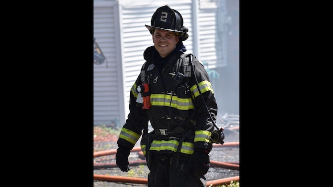 Tech. Sgt. Brian Nasuta, an aerial transportation specialist with the 58th Aerial Port Squadron, smiles for a photo while on a firefighting assignment on June 14, 2020, in Windsor, Connecticut. Nasuta has been a firefighter for 10 years. (Courtesy photo by South Green Fire Photos)
