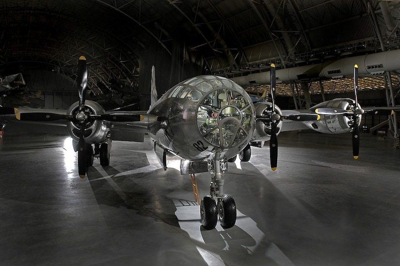 A refurbished B-29 Superfortress sits inside a large hangar.