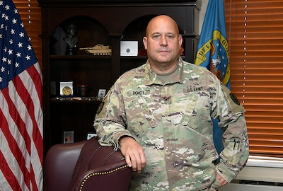 Army Col. Wayne Bondy stands in his DLA Disposition Services office.