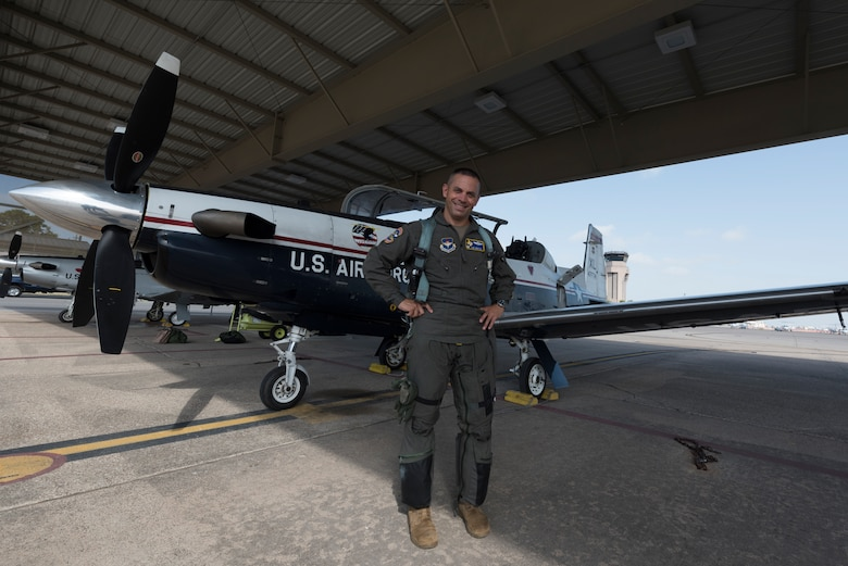 Col. Lee Gentile, 47th Flying Training Wing commander, stands in front of a T-6 Texan II, July 17, 2020 at Laughlin Air Force Base Texas. Like all other instructor pilots of Team XL, Gentile attended pilot instructor training. This enabled him to impart his years' worth of knowledge and experience to the younger instructor pilots of the flying training squadrons here. (U.S. Air Force photo by Senior Airman Anne McCready)