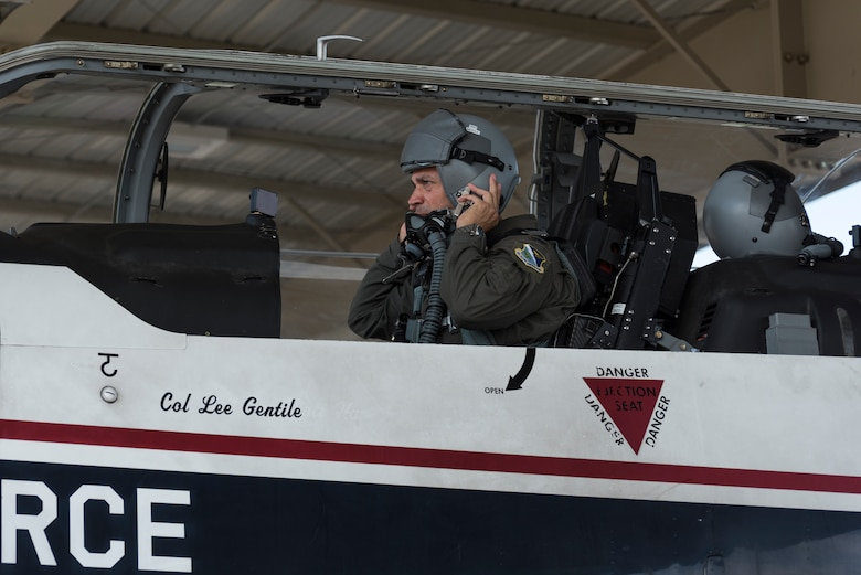 Col. Lee Gentile, 47th Flying Training Wing commander, secures his helmet as he prepares for his fini flight, July 17, 2020 at Laughlin Air Force Base Texas. Fini flights are a tradition marking the last flight a pilot takes in the aircraft flown at a certain place, or sometimes the last time they ever fly a plane. (U.S. Air Force photo by Senior Airman Anne McCready)