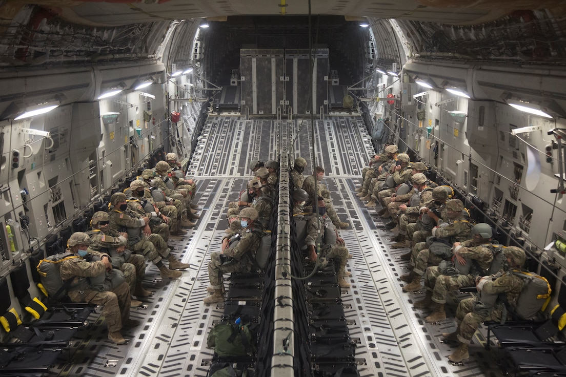 Army Soldiers sitting on cargo aircraft