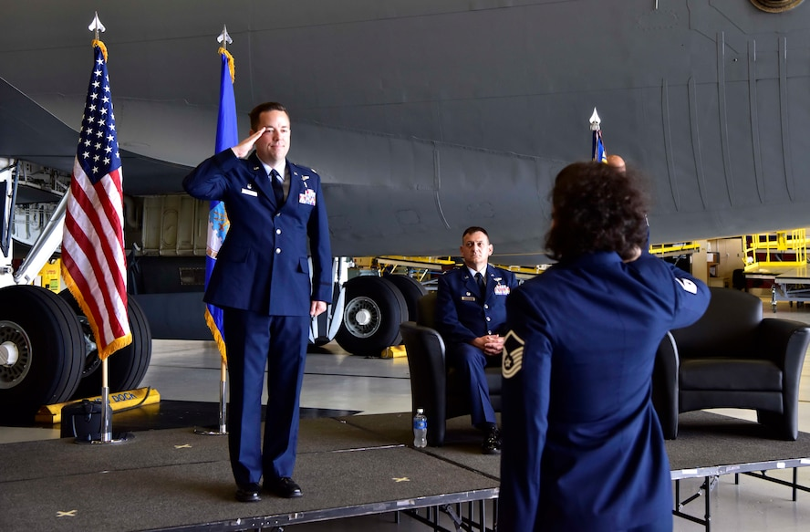 U.S. Air Force Lt. Col. Clayton Rabens, the new 354th Medical Operations Squadron commander, receives a salute from Master Sgt. Ashley Carabello, the 354th MDOS superintendent, at his assumption of command ceremony at Eielson Air Force Base, Alaska, July 17, 2020. The assumption of command is a ceremony rooted deep in military history and tradition dating back to the time of Frederick the Great of Prussia. (U.S. Air Force photo by Senior Airman Beaux Hebert)