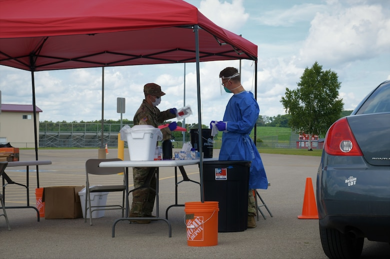 Citizen-Soldiers and Citizen-Airmen from the Wisconsin National Guard collect specimens for COVID-19 testing July 13, 2020, at a community-based test site at the Eleva-Strum High School in Strum, Wis. The Wisconsin National Guard has collected more than 256,000 specimens statewide.