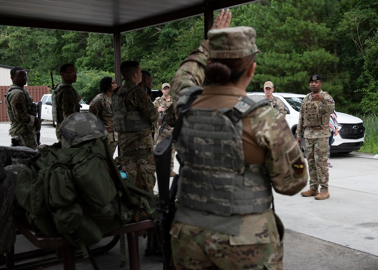 Airman Leadership School graduates ask members of the Security Forces Squadron questions prior to beginning the combat skills training course at Seymour Johnson Air Force Base, North Carolina, July 13, 2020.