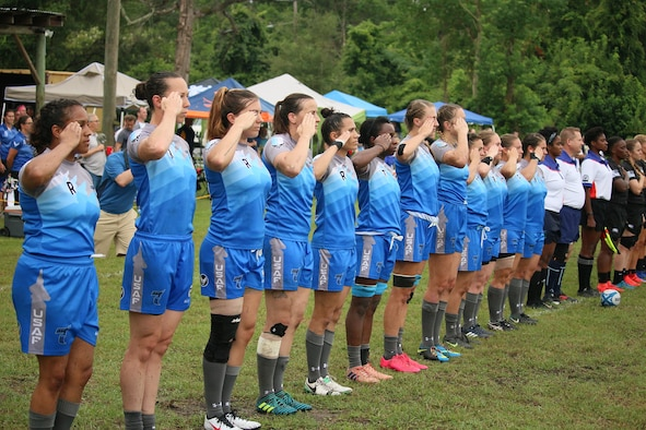 Air Force Women's Rugby Team salutes at game