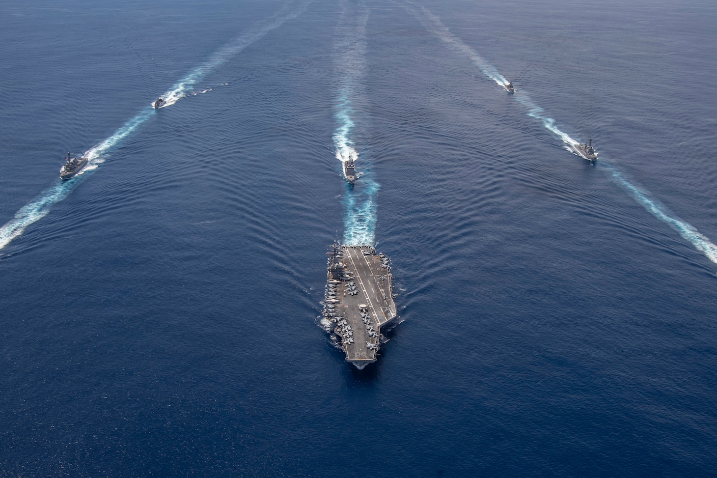 Ships sail in formation.