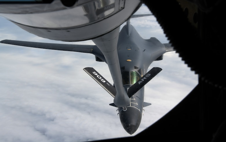 A U.S. Air Force B-1B Lancer from the 28th Bomb Wing, Ellsworth Air Force Base, S.D., approaches a KC-135 Stratotanker from the 909th Air Refueling Squadron, to refuel over the Pacific as part of a bilateral U.S. Indo-Pacific Command and U.S. Strategic Command (USSTRACTCOM) Bomber Task Force (BTF) mission July 17, 2020.  This operation demonstrates the U.S. Air Force's dynamic force employment model in line with the National Defense Strategy's objectives of strategic predictability with persistent bomber presences, assuring allies and partners. (U.S. Air Force photo by Airman 1st Class Rebeckah Medeiros)