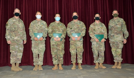 (From left) Maj. Gen. Dennis LeMaster, Spc. Tristan Chandler, Staff Sgt. Ryan Morgan, Sgt. 1st Class Jeremy Shepler, Drill Sgt. Travis Webster, and Command Sgt. Maj. Clark Charpentier at the Trinity Competition awards ceremony at Joint Base San Antonio-Fort Sam Houston July 20.