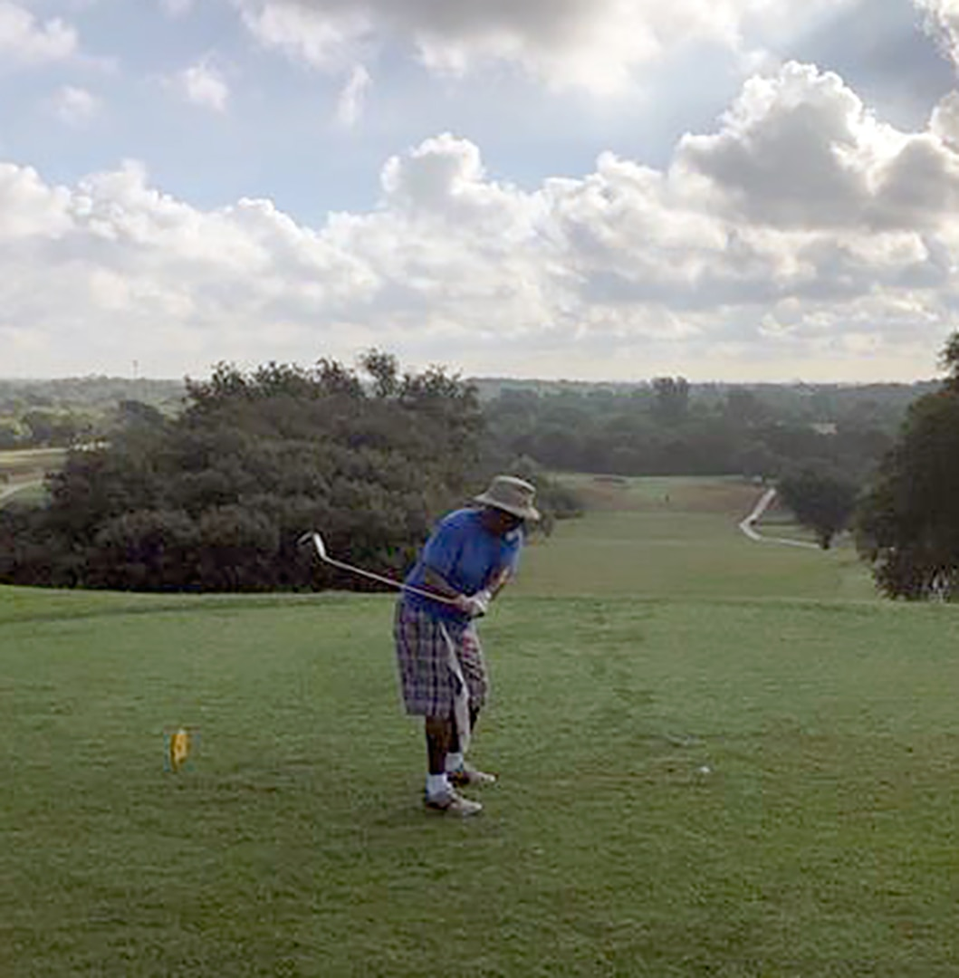 A golfer tees up at the Joint Base San Antonio-Lackland Gateway Hills Golf Course.
