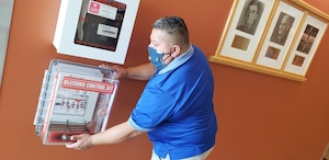 """Chris Talamantez installs a """"Stop the Bleed"""" kit at Brooke Army Medical Center, Fort Sam Houston, Texas, July 17, 2020. The kits, which contain items such as a tourniquet and trauma dressing, are part of the Stop the Bleed campaign, an initiative to aid an injured person in the event of uncontrolled bleeding. (U.S. Army photo by Corey Toy)"""