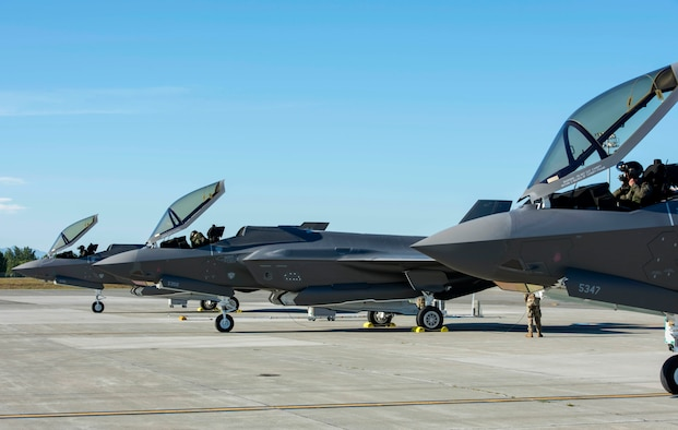 Three U.S. Air Force F-35A Lightning II pilots assigned to Eielson Air Force Base, Alaska, prepare to fly a training sortie out of Joint Base Elmendorf-Richardson, Alaska, July 14, 2020.