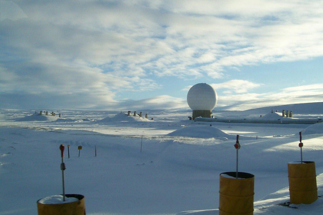 A golf-ball-like radar dome sits in a snowy landscape.