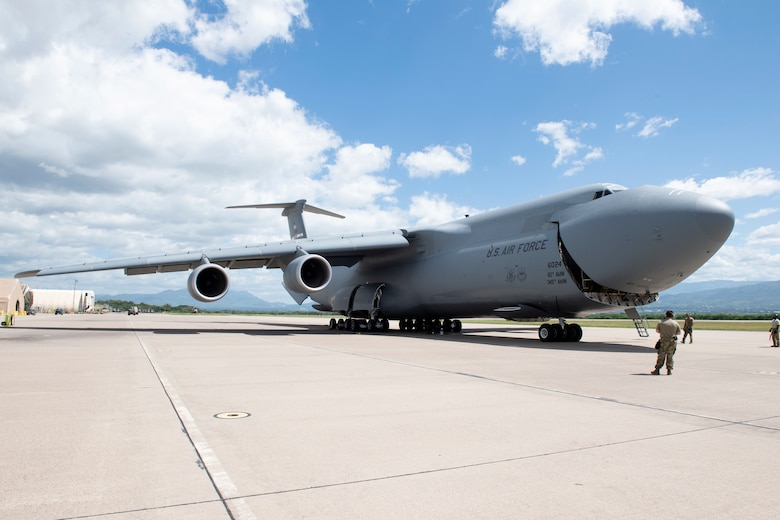 U.S. Airmen assigned to the 22nd Airlift Squadron, open the nose of a C-5M Super Galaxy to off-load cargo July 18, 2020, at Soto Cano Air Base, Honduras. The C-5M Super Galaxy is a strategic transport aircraft and is the largest aircraft in the Air Force inventory. Its primary mission is to transport cargo and personnel for the Department of Defense. (U.S. Air Force photo by Senior Airman Jonathon Carnell)