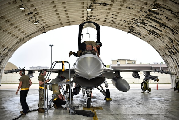 A photo of Airmen performing maintenance on aircraft.