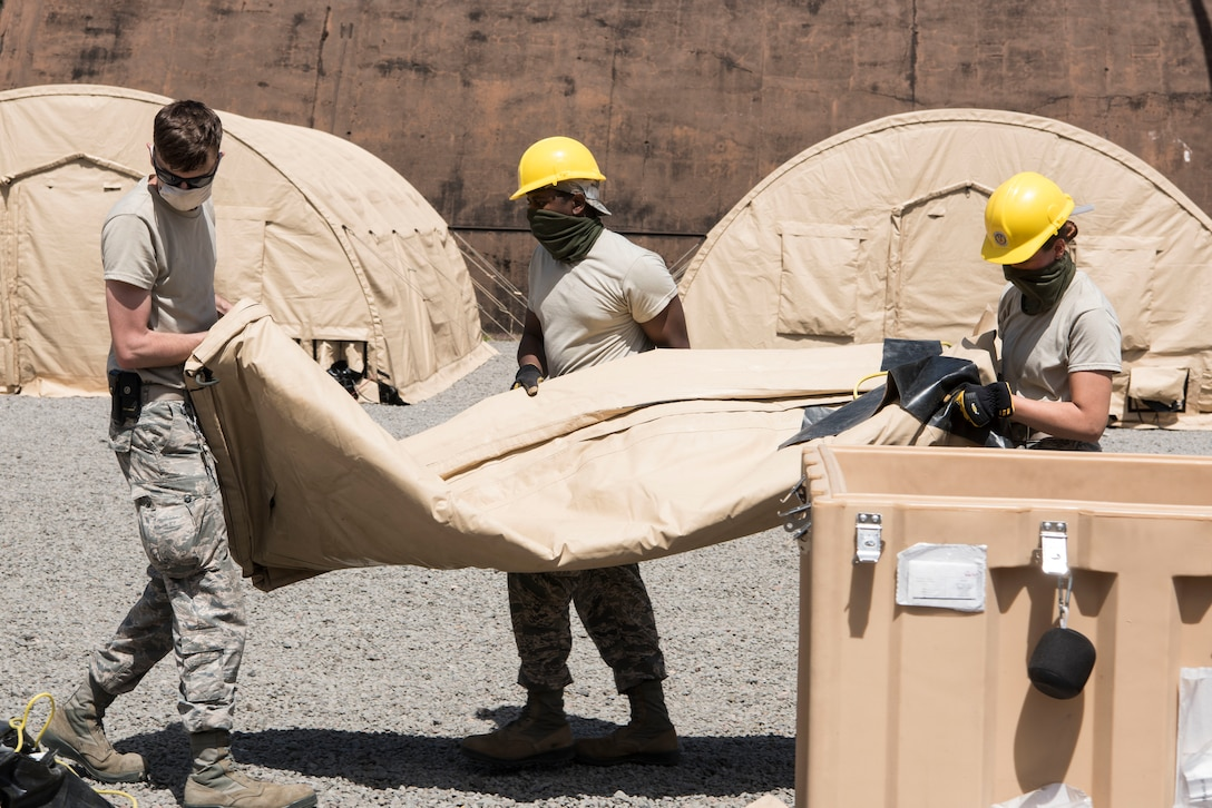 U.S. Air Force Airmen move tent materials during Silver Flag.