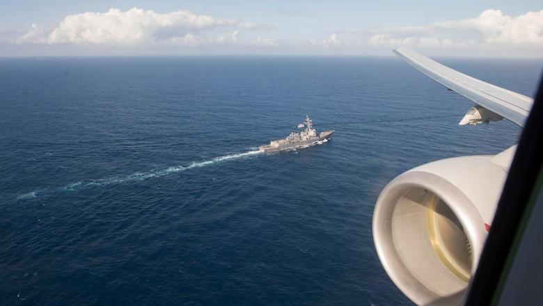 The Arleigh Burke-class guided-missile destroyer USS Roosevelt (DDG 80) as seen from the window of a P-8A Poseidon multi-mission maritime patrol and reconnaissance aircraft assigned to Patrol Squadron (VP), April 23.