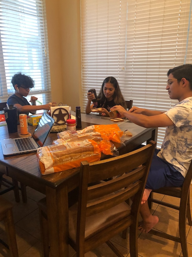 The Lamar family pitches in to make peanut butter and jelly sandwiches for those in need in the local area. Reserve Citizen Airmen from the 23rd Intelligence Squadron donated more than 1,000 peanut butter and jelly sandwiches in the last month to local San Antonians in need.