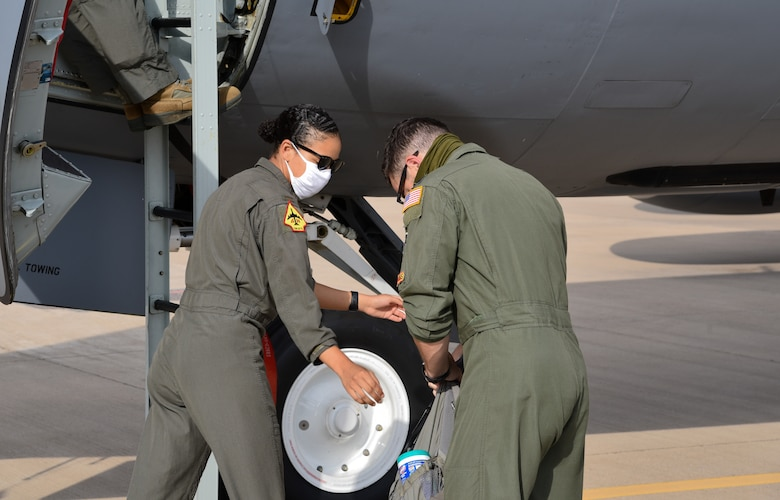 2nd Lt. Keisha Holback and Capt. Ryan Burkitt, 465th air Refueling Squadron pilots, load cleaning supplies onto a KC-135R Stratotanker before a sortie July 21, 2020, at Tinker Air Force Base, Oklahoma. (U.S. Air Force photo by Senior Airman Chad Dixon)