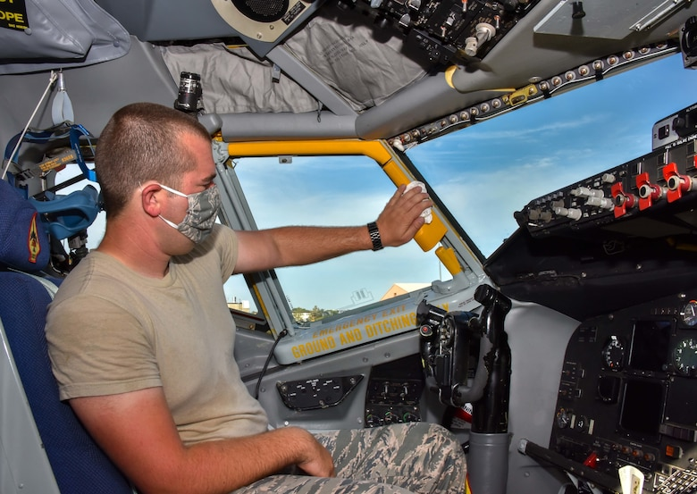 Senior Airman Joshua Thomas, 507th Aircraft Maintenance Squadron crew chief, sanitizes the flight deck of a KC-135R Stratotanker July 20, 2020, at Tinker Air Force Base, Oklahoma. Routine cleaning mitigates the spread of COVID-19 and keeps aircrews safe. (U.S. Air Force photo by Senior Airman Mary Begy)