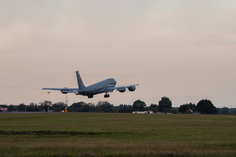 Military aircraft taking off.