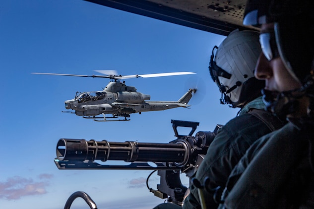An AH-1Z Viper helicopter flies alongside a UH-1Y Venom helicopter during an aerial gunnery range at Naval Air Facility El Centro, California, July 16, 2020. The range was part of Exercise Summer Fury, a three-week training evolution conducted by Marines and sailors with 3rd MAW, 1st Marine Division and the 1st Marine Logistics Group to refine the capability of the Marine Air-Ground Task Force to conduct expeditionary advanced basing operations. (U.S. Marine Corps photo by Lance Cpl. Drake Nickels)