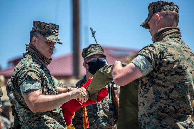 U.S. Marine 1st Sgt. Adam Casas, left, the company first sergeant of Alpha Company, 4th Tank Battalion, 4th Marine Division, Marine Force Reserve, and Capt. Mark Rothrock, the company commander of Alpha Co., 4th Tank Bn., 4th MarDiv, MARFORRES, case the company's colors during the company's deactivation ceremony in 41 Area on Marine Corps Base Camp Pendleton, California, July 18, 2020. Alpha Co., along with the rest of 4th Tank Bn., was activated in 1943 during World War II. Since then, the battalion has participated in every war the Marine Corps has fought in. Alpha Co. is the first of 4th Tanks' six companies to deactivate. The Marine Corps is divesting its tank battalions following the commandant's guidance in Force Design 2030. Casas is a native of Murrieta, California, and Rothrock is a native of Raleigh, North Carolina. (U.S. Marine Corps photo by Lance Cpl. Alison Dostie)
