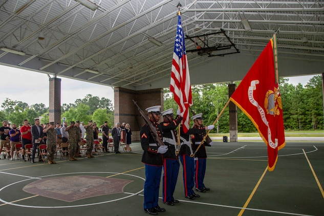 U.S. Marines with Wounded Warrior Battalion-East (WWBN-E) present colors during a retirement ceremony for Staff Sgt. Darron Dale at WWBN-E on Marine Corps Base Camp Lejeune, North Carolina, June 19, 2020. Dale, a Houston, Texas native, enlisted in 2006 and deployed six times during his Marine Corps career. Dale is set to retire June 29, 2020, with plans for employment with a federal agency or hospital administration. (U.S. Marine Corps photo by Cpl. Karina Lopezmata)