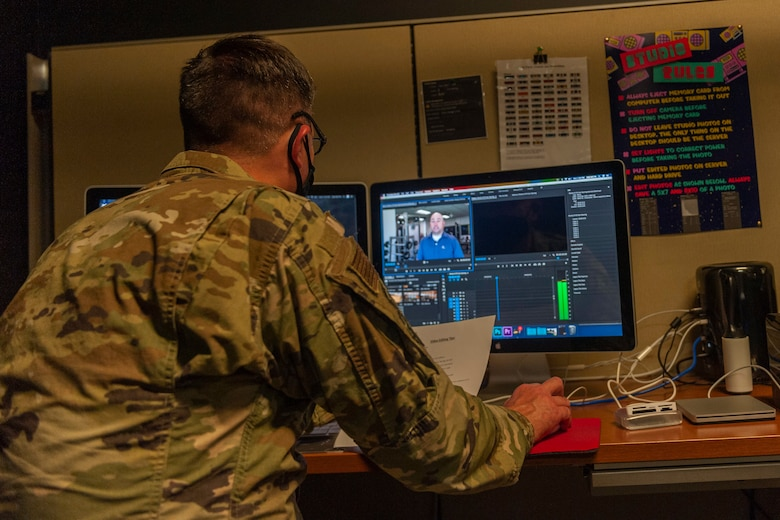 Photo of Col. Walls editing a video