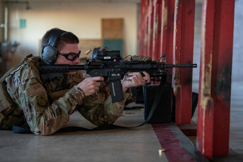 U.S. Air Force Capt. Gregory Speirs, 621st Contingency Response Wing judge advocate, fires the M-4 Rifle May 27, 2020, during an M-4 Rifle/Carbine Air Force qualification course at Travis Air Force Base, California. Speirs completed the course at the 60th Security Forces Squadron combat arms training and maintenance range. The CATM section trains Airmen on 10 weapon systems each year. (U.S. Air Force photo by Tech. Sgt. James Hodgman)