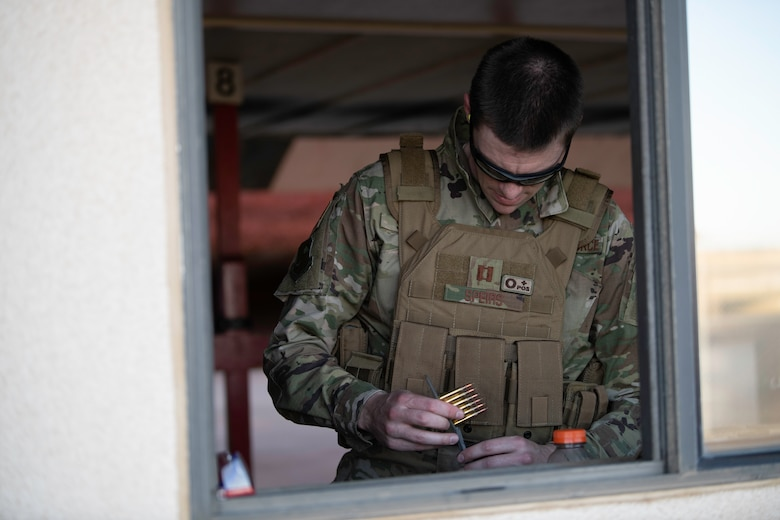 U.S. Air Force Capt. Gregory Speirs, 621st Contingency Response Wing judge advocate, loads 5.56 mm frangible rounds into a magazine at Travis Air Force Base, California, May 27, 2020. Speirs participated in an M-4 Rifle/Carbine Air Force qualification course at the 60th Security Forces Squadron combat arms training and maintenance range. The CATM section trains Airmen on 10 weapon systems. (U.S. Air Force photo by Tech. Sgt. James Hodgman)