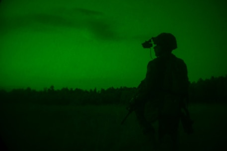 A U.S. Marine with Golf Company, 2d Battalion, 2d Marine Regiment (V22), 2d Marine Division, oversees a night live-fire range at Fort A.P. Hill, Virginia, July 19, 2020. Marines with V22 are training in a simulated realistic setting and environment to improve combat effectiveness and readiness. (U.S. Marine Corps photo by Lance Cpl. Reine Whitaker)